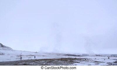 Geyser eruption of Strokkur - Visitors at the geyser...