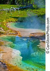 Deep inside blue green geyser in Yellowstone National Park