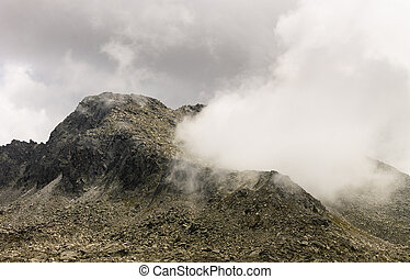 Geyser Shaped Cloud Coming from Mountain Crater