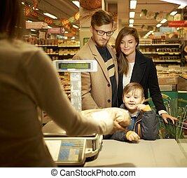 gezin, aankoop, brood, in, een, grocery slaan op