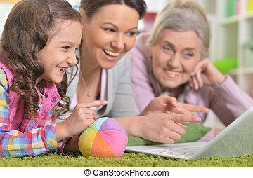 gezin, draagbare computer, vrolijke , gebruik