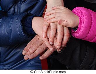 gezin, het samenhouden, handen