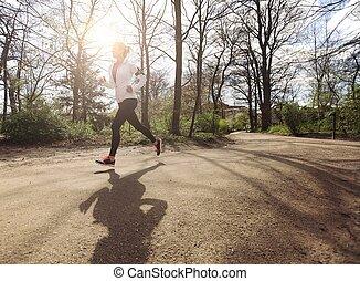 gezonde , jonge vrouw , jogging, in park