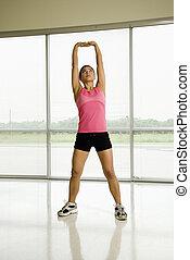 gezonde vrouw, stretching.