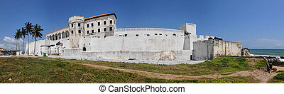 """Elmina Castle (also called the Castle of St. George) is located on the Atlantic coast of Ghana west of the capital, Accra. It is part of the UNESCO World Heritage Site called """"Forts and Castles, Volta, Greater Accra, Central and Western Regions."""" Built by the Portuguese in 1482, it was, as UNESCO ..."""