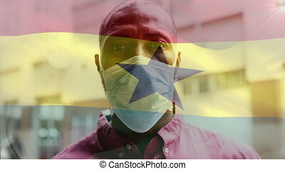 Animation of Ghana flag waving over mixed race man wearing a face mask. Covid-19 coronavirus national health safety concept digital composite