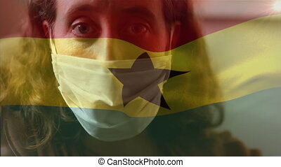 Animation of Ghana flag waving over Caucasian woman wearing a face mask. Covid-19 coronavirus national health safety concept digital composite