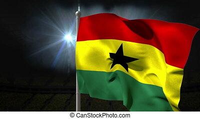 Ghana national flag waving on flagpole on black background...