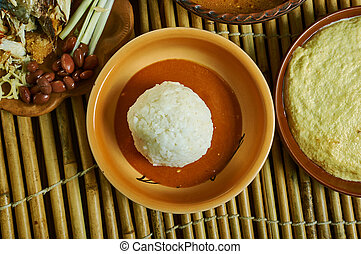 Omo Tuo and Groundnut Soup, staple food made with rice, Ghanaian cuisine, Traditional assorted African dishes, Top view.