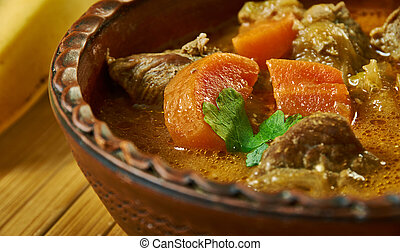 Palmnut soup with goat, Ghanaian cuisine, Traditional assorted African dishes, Top view.