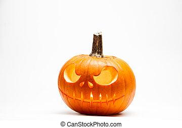 Ghastly Halloween pumpkin head jack lantern with burning...