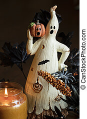 Ghost and Pumpkin - A ghost and pumpin sitting by a lit...