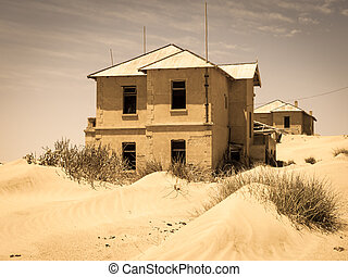 Ghost buildings of old diamond mining town Kolmanskop in Namibia