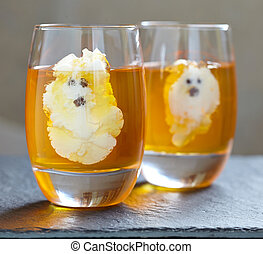 Ghost Jello Treats for Halloween. Orange jelly and whipped ...