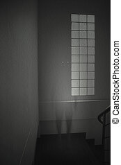 Ghost manl in white dress appears in an old room