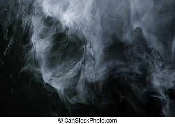 Appearance of cigarette smoke forming the shape of a skull. Good for stop smoking - quit smoking ad, advertisement, campaign or brochure. Dry ice carbon dioxide gasses forming an image of a scary skull.