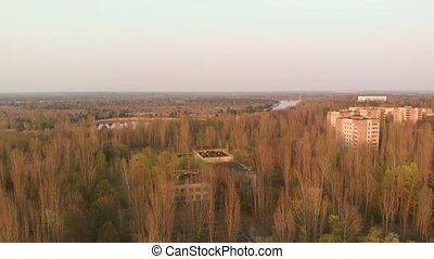 Landscape top view of the nuclear power plant in Chernobyl opens. Views of the city of Pripyat near the Chernobyl nuclear power plant at sunset, aerial view.