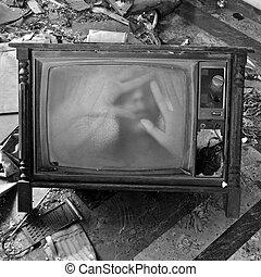 ghostly figure on vintage tv set