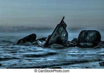 Ghostly Ship - Ghostly shipwreck on the rocks on a cloudy...