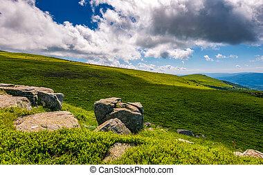 giant boulders on grassy slopes of Polonina Runa. beautiful...