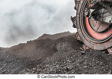 Giant bucket wheel excavator for digging the brown coal, Czech Republic. Cloudy sky.