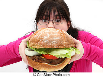 Giant Burger - Super huge giant burger and teen girl trying...