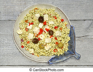Giant couscous salad with olives