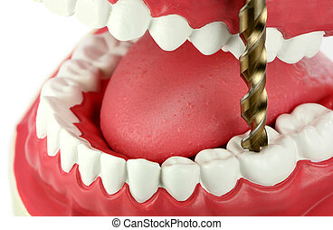 A giant drill bit is drilling a tooth with tooth decay. Fear of dentists concept.