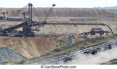 giant excavator digging on open coal mine