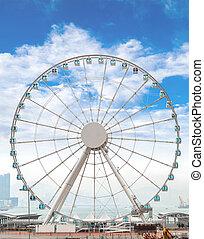 Giant Ferris Wheel in Hong Kong Overlooking Victoria Harbor