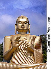 Giant gold Bhudda - Giant Golden Buddhaa with dramatic sky....
