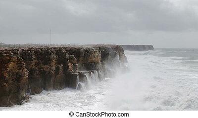 Giant Hercules waves break over the shore in Sagres. Costa ...