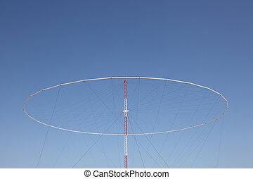 Giant military antenna against blue sky