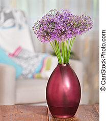 Giant Onion (Allium Giganteum) flowers in the flower vase on table in the living room