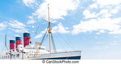 Giant passenger Steam Boat with blue sky copy space