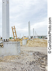 Giant reinforced concrete column with used wooden ladders