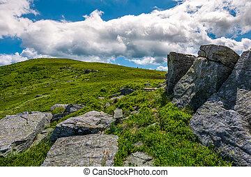 giant rocks on a hill in summertime. beautiful landscape...