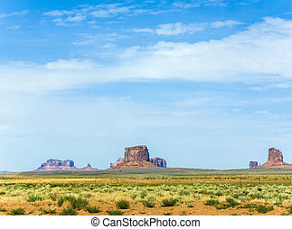 giant sandstone formation in the Monument valley under blue...
