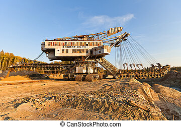 Giant stacker (absetzer) Takraf Ers 710 in sand pit near Voskresensk, Russia. The last survived stacker in Moscow region