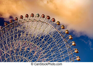 Giant wheel against sky in amusement attraction park