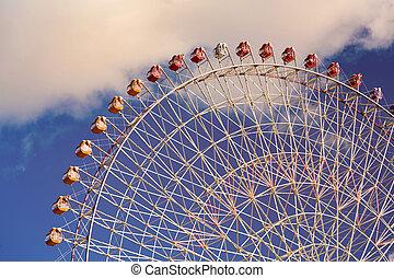 Giant wheel bottom view against blue sky background