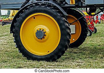 Giant wheel farm vehicle that provides irrigation