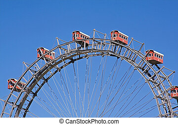 Giant wheel in front of a blue sky