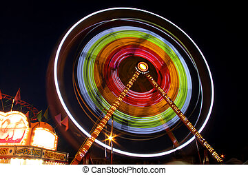 Rotating carnival giant wheel in night time