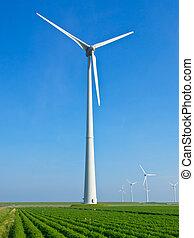 Giant wind turbine in dutch agricultural landscape