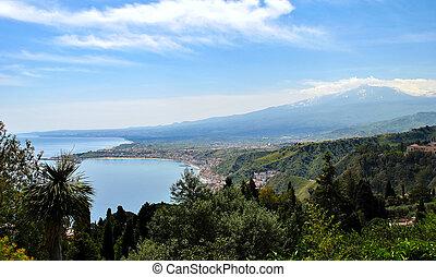 Giardini-Naxos bay with the Etna volcano - The bay of...