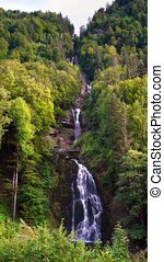 View of Giessbach Waterfall at Brienzersee Lake in Switzerland