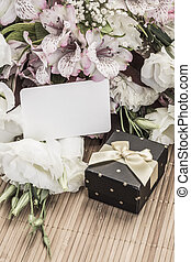gift and flowers with name tag