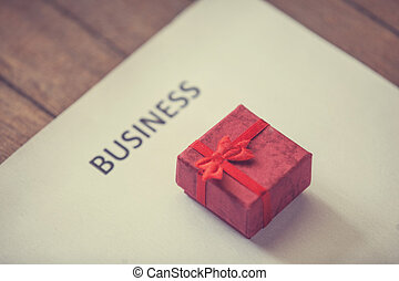 Gift and paper with business text