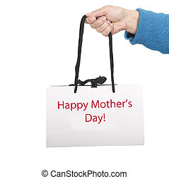 Gift bag for mother's day - Hand in blue sweater holding ...